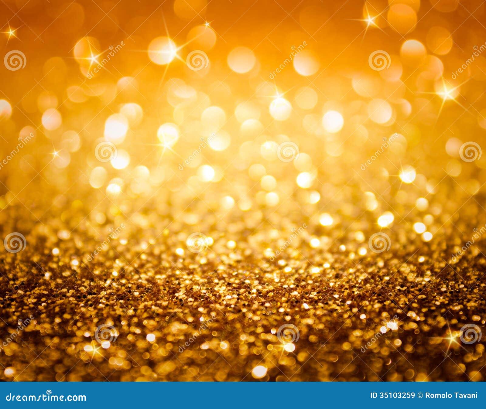 Scintillio dorato e stelle per il fondo di natale