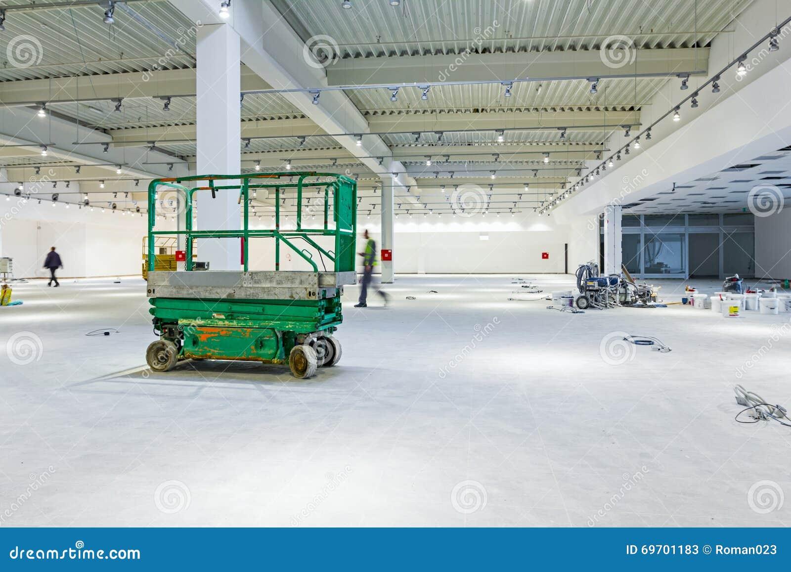 Scissor Lift Platform On A Construction Site  Stock Image - Image of