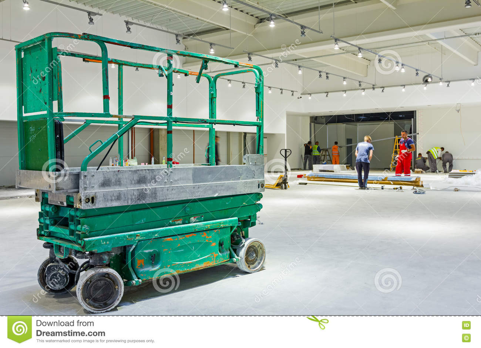 Scissor Lift Platform On A Construction Site  Editorial Image