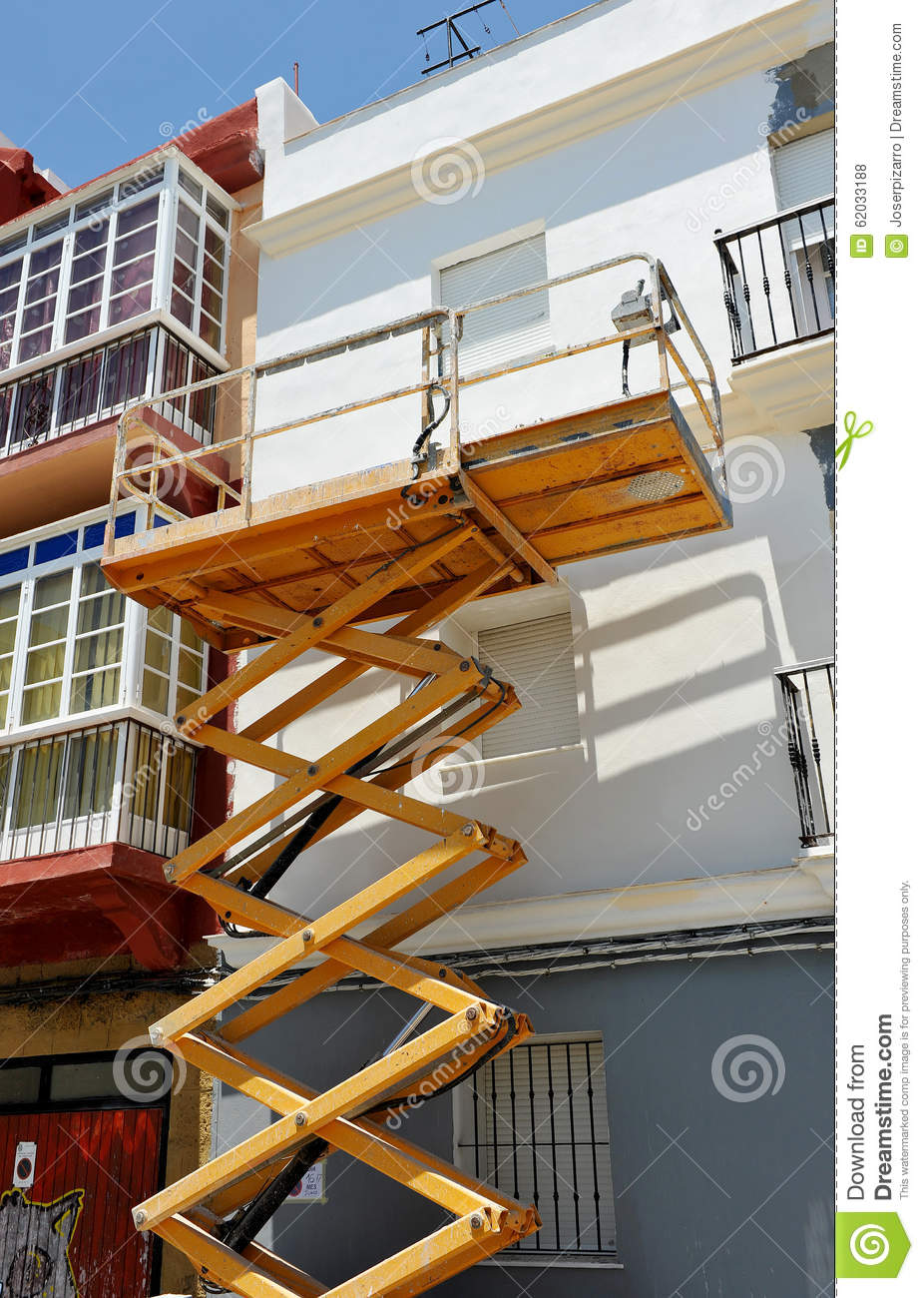 Scissor Lift Platform For Repair Of The Facade Of A House Stock Photo Image Of Masonry
