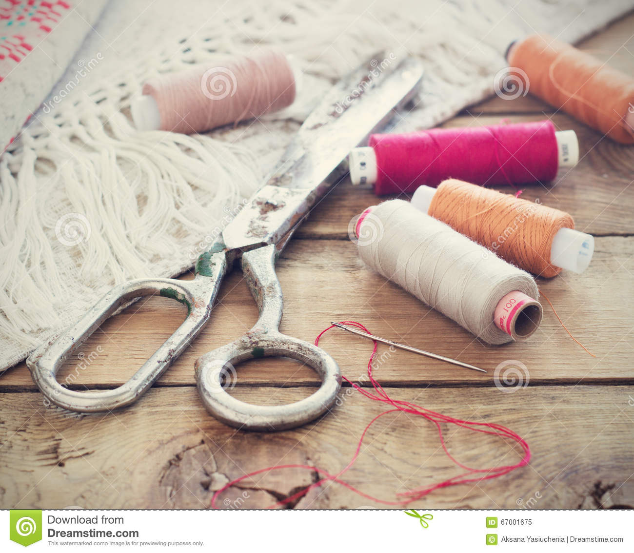 Scissors bobbins with thread and needles striped fabric for Sewing materials