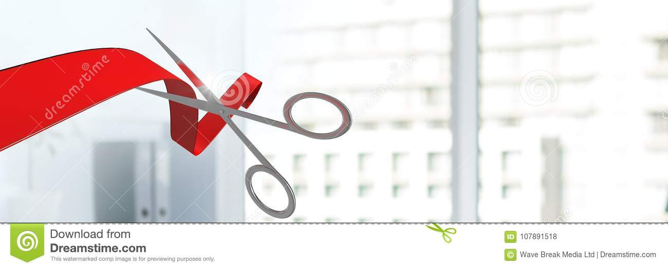 scissors cutting ribbon with office windows of buildings stock po ...