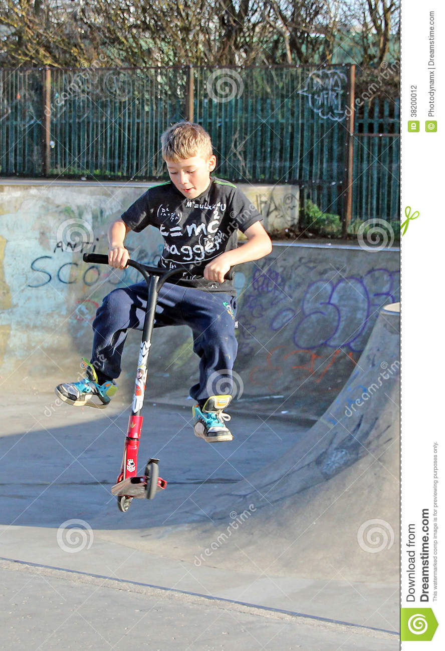 Scooter boy at skate park editorial photography. Image of ...