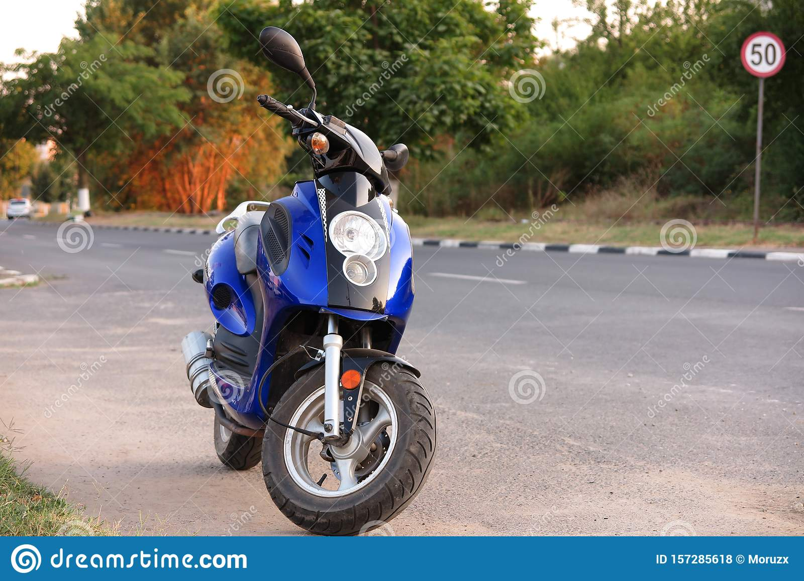 Scooter Moped Near A 50 Km/h Speed Limit Indicator Stock