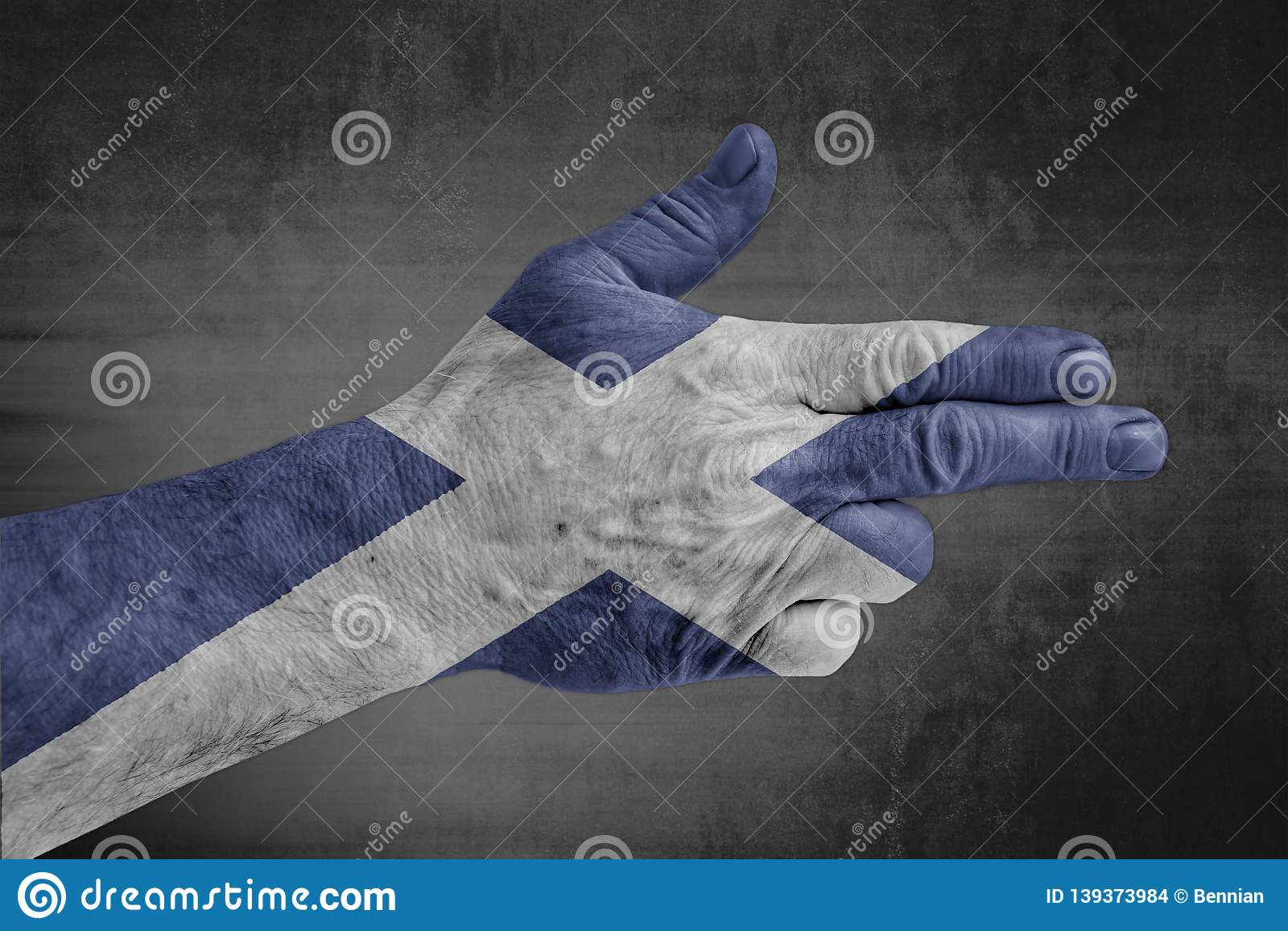 Scotland flag painted on male hand like a gun