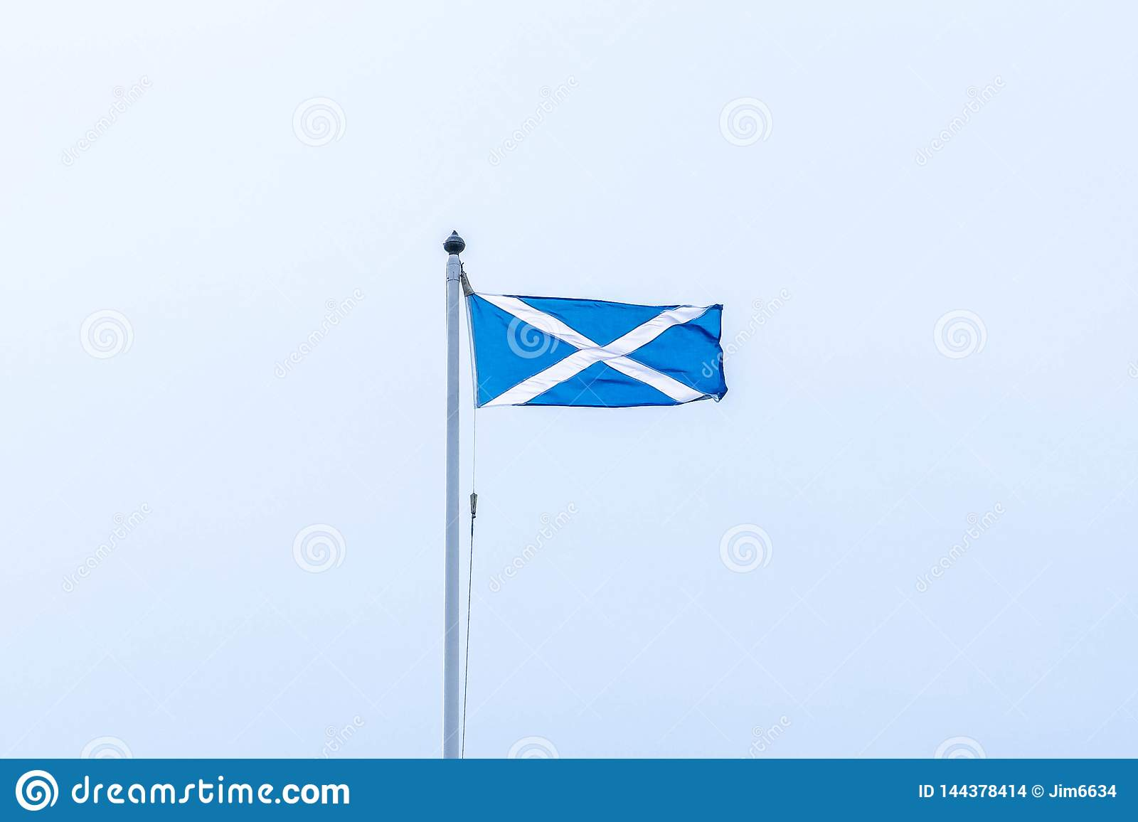 Scotlands Saltire Flag Flying High on Top of One of Scotlands Historic Castles in Seamill Scotland