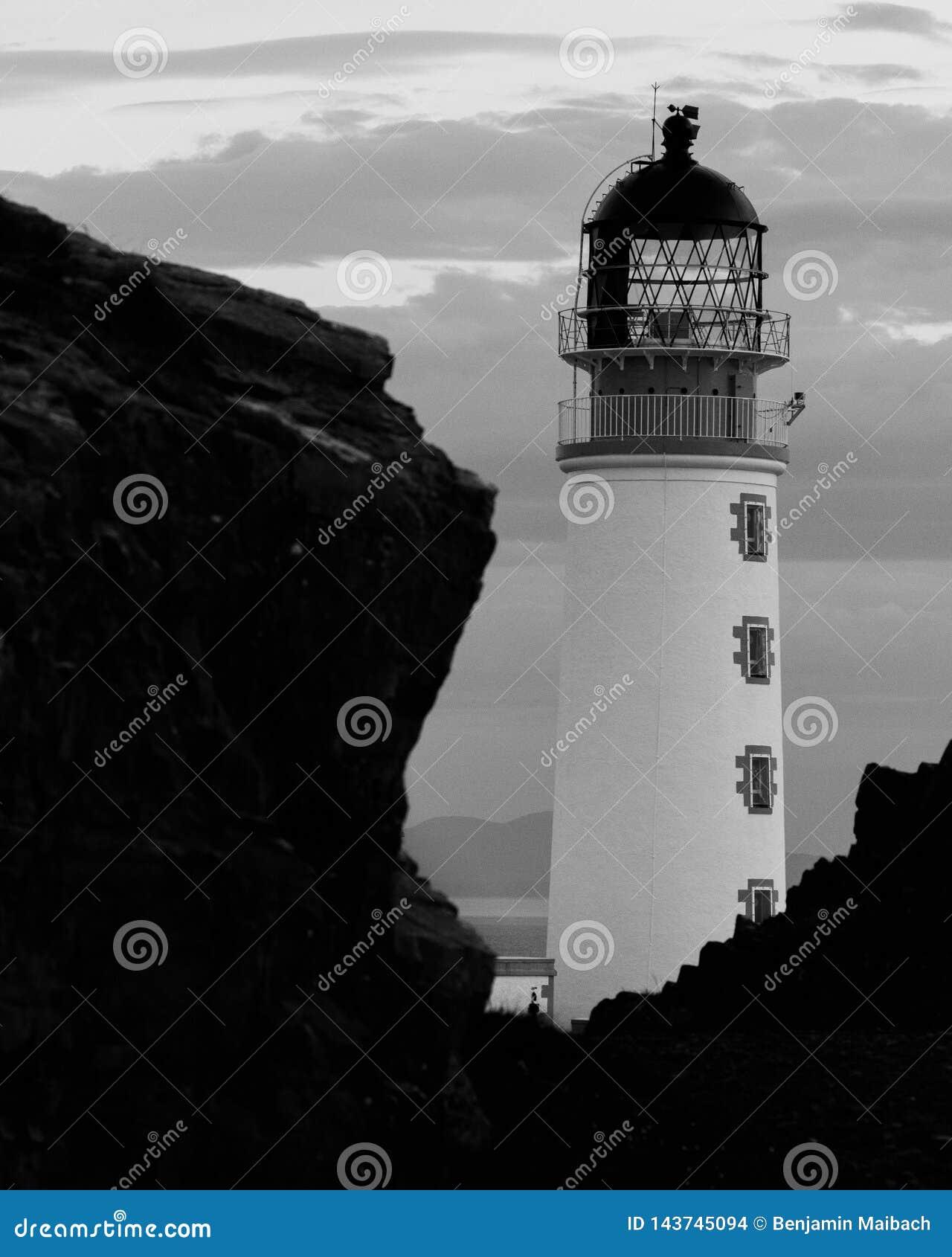 Scottish lighthouse next to cliff