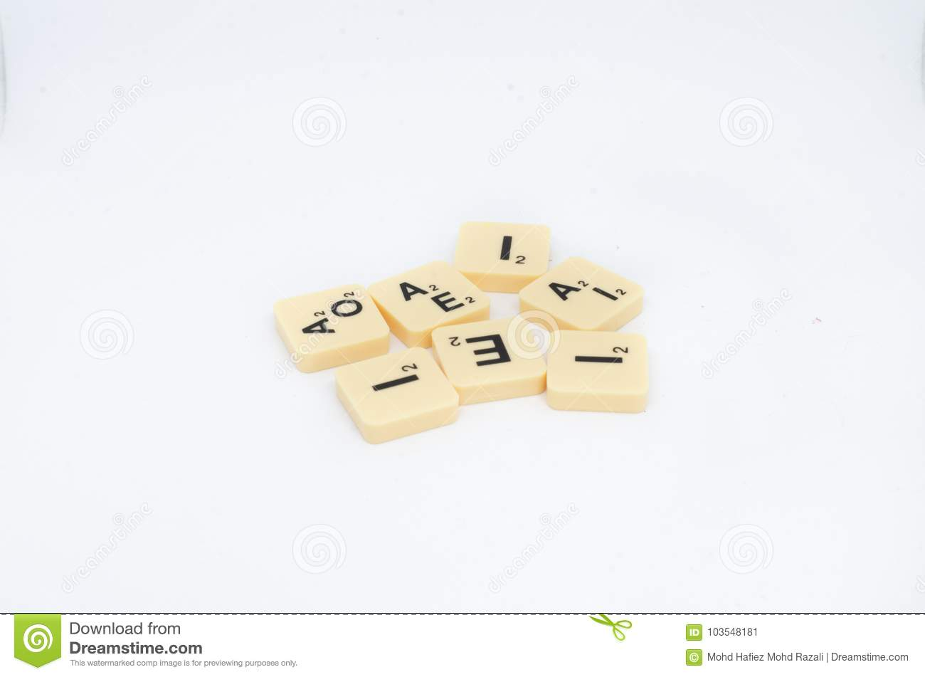 Scrabble board game letter blocks isolated on a white background
