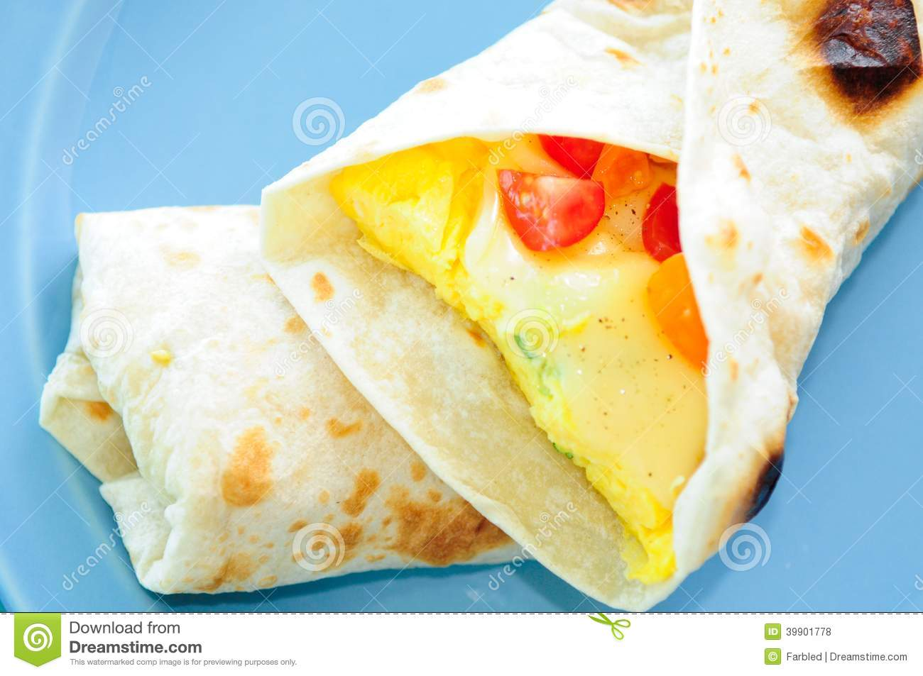 Scrambled Egg Breakfast Burrito With Tomatoes And Green Onion An Stock ...