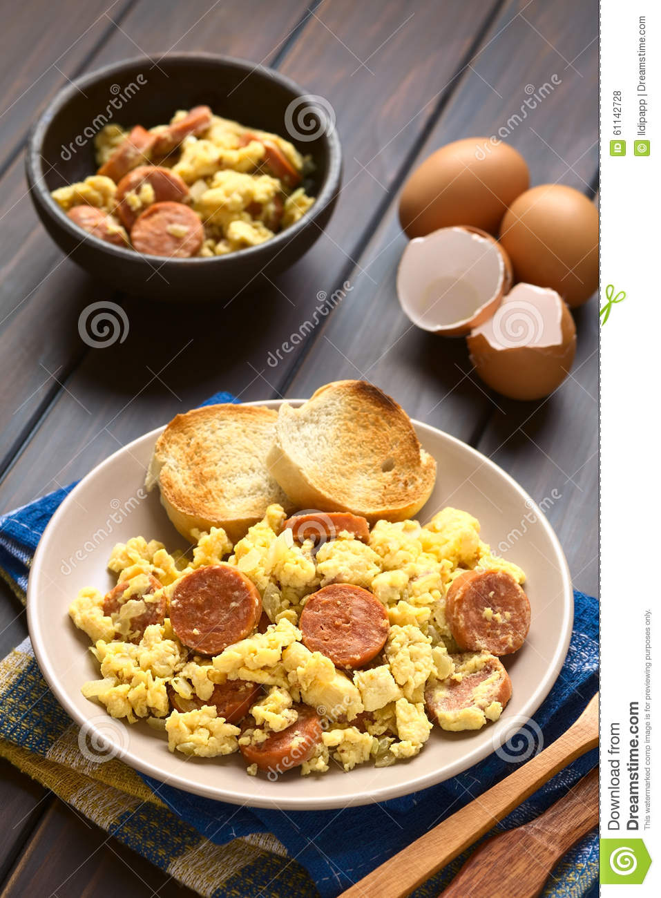 Scrambled eggs made with chorizo slices and onion on plate with ...