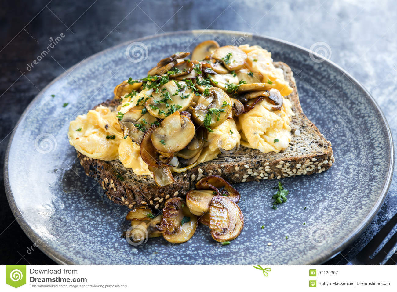 Scrambled Eggs And Mushrooms On Wholewheat Toast