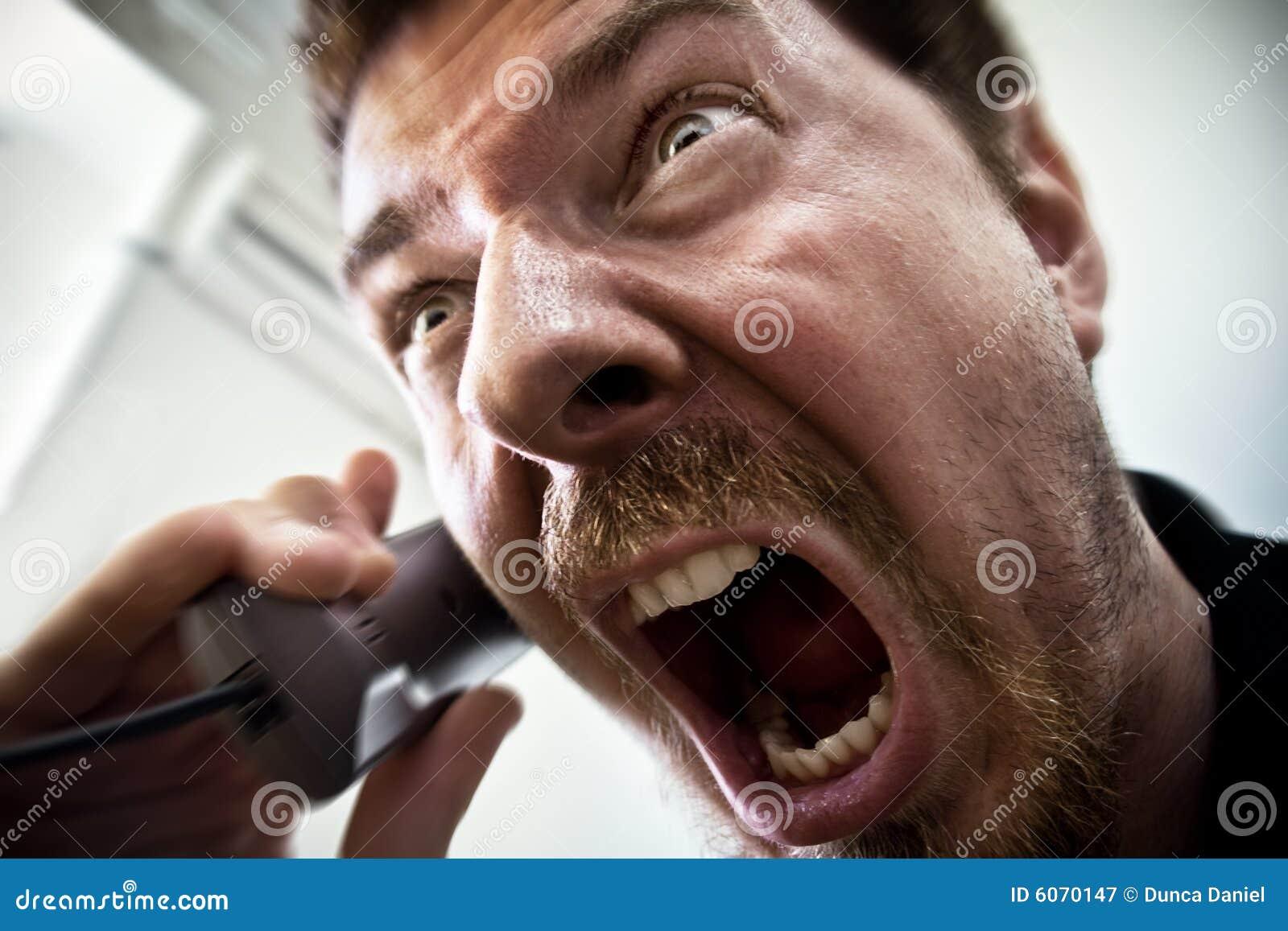 Scream of stressed man at phone