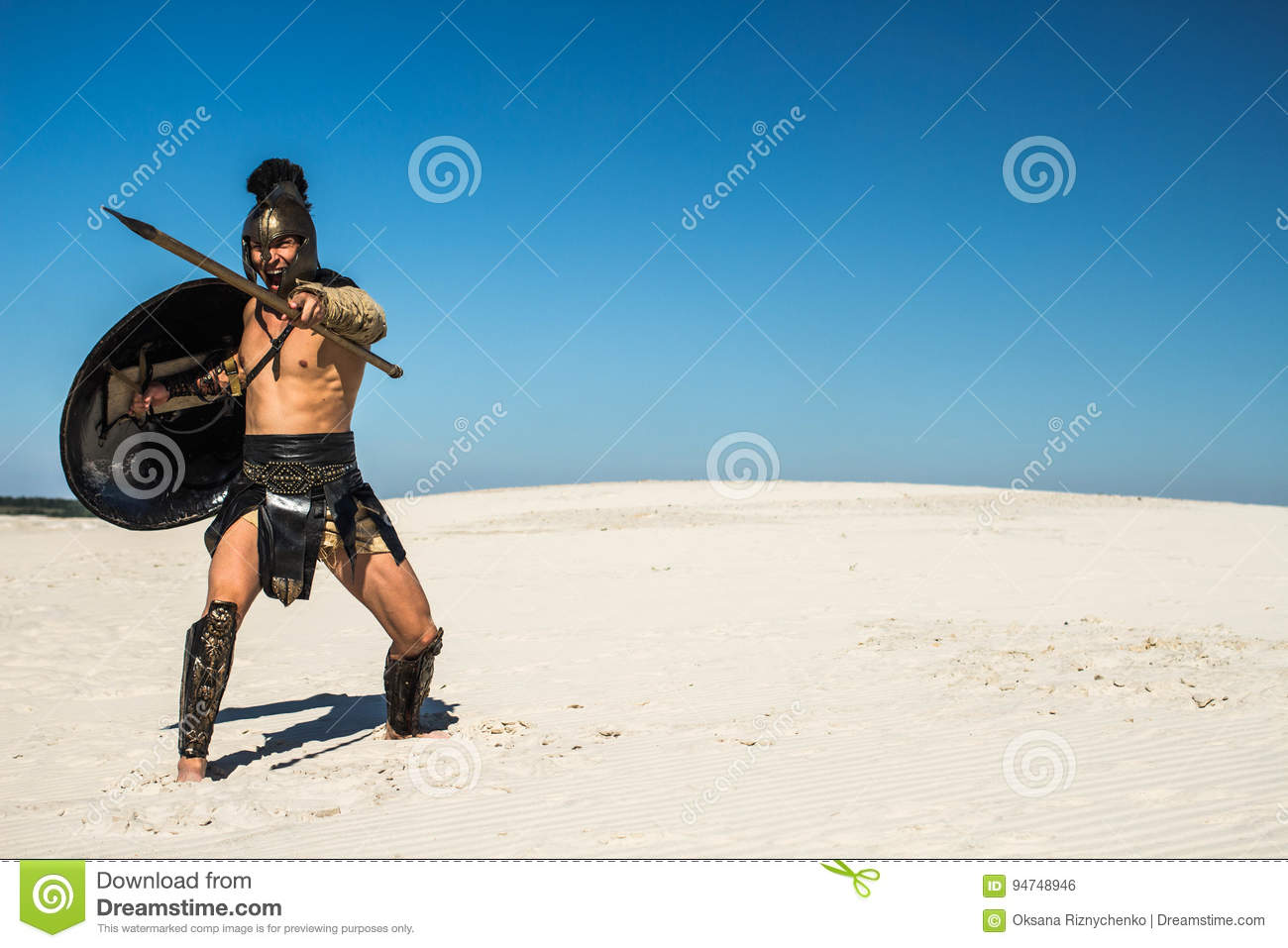 Screaming Ancient Roman Warrior With Spear And Shield Stock Photo