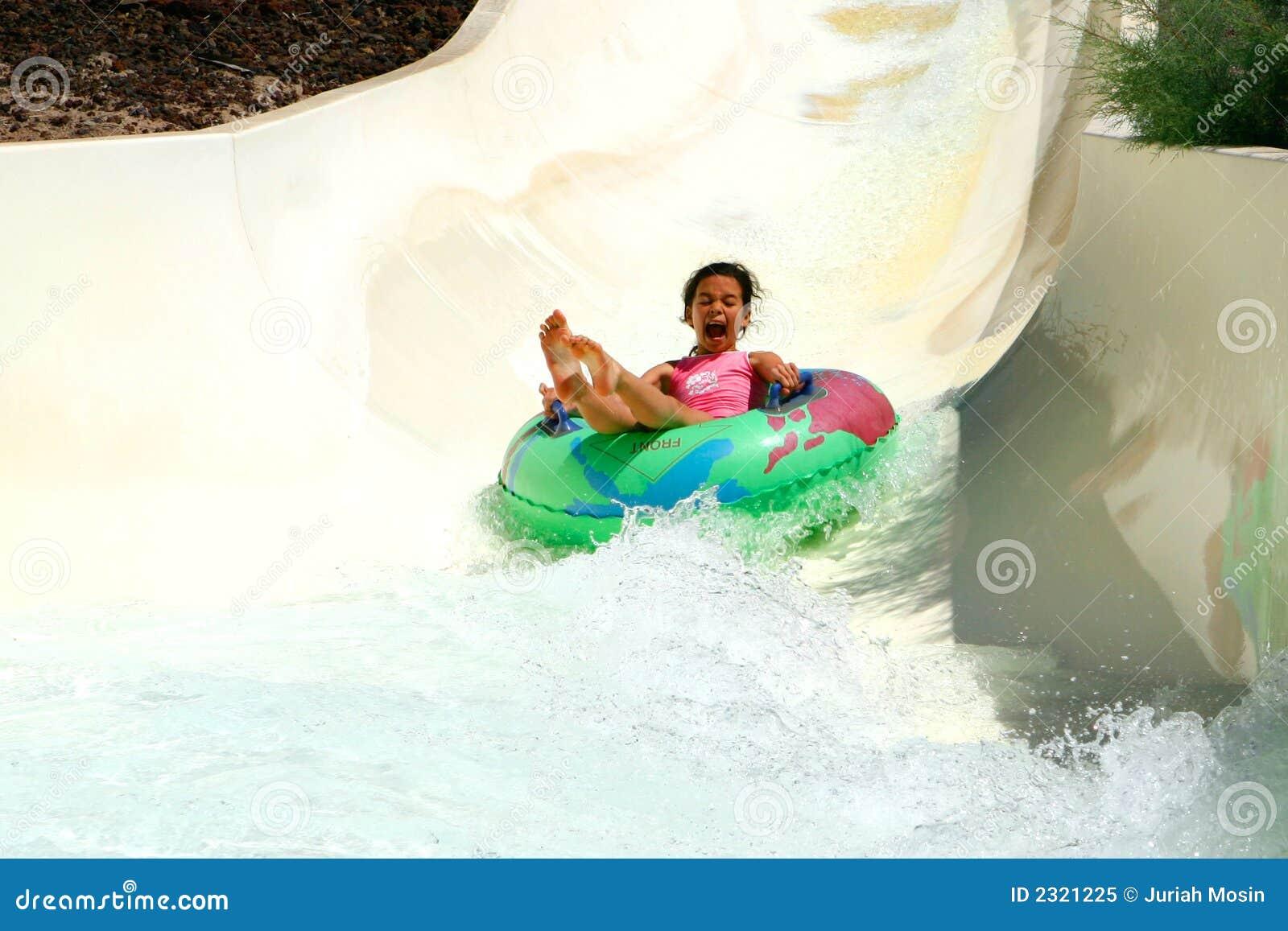 Screaming girl down the slide