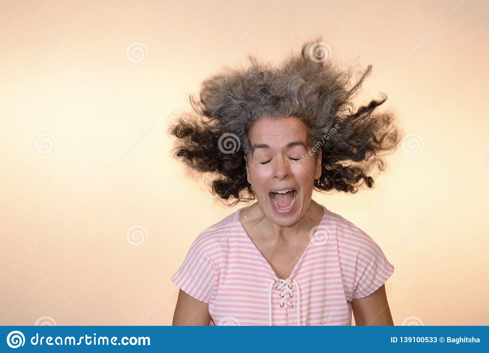 Bad Hair Day Screaming Woman Flying Graying Hair Stock Image