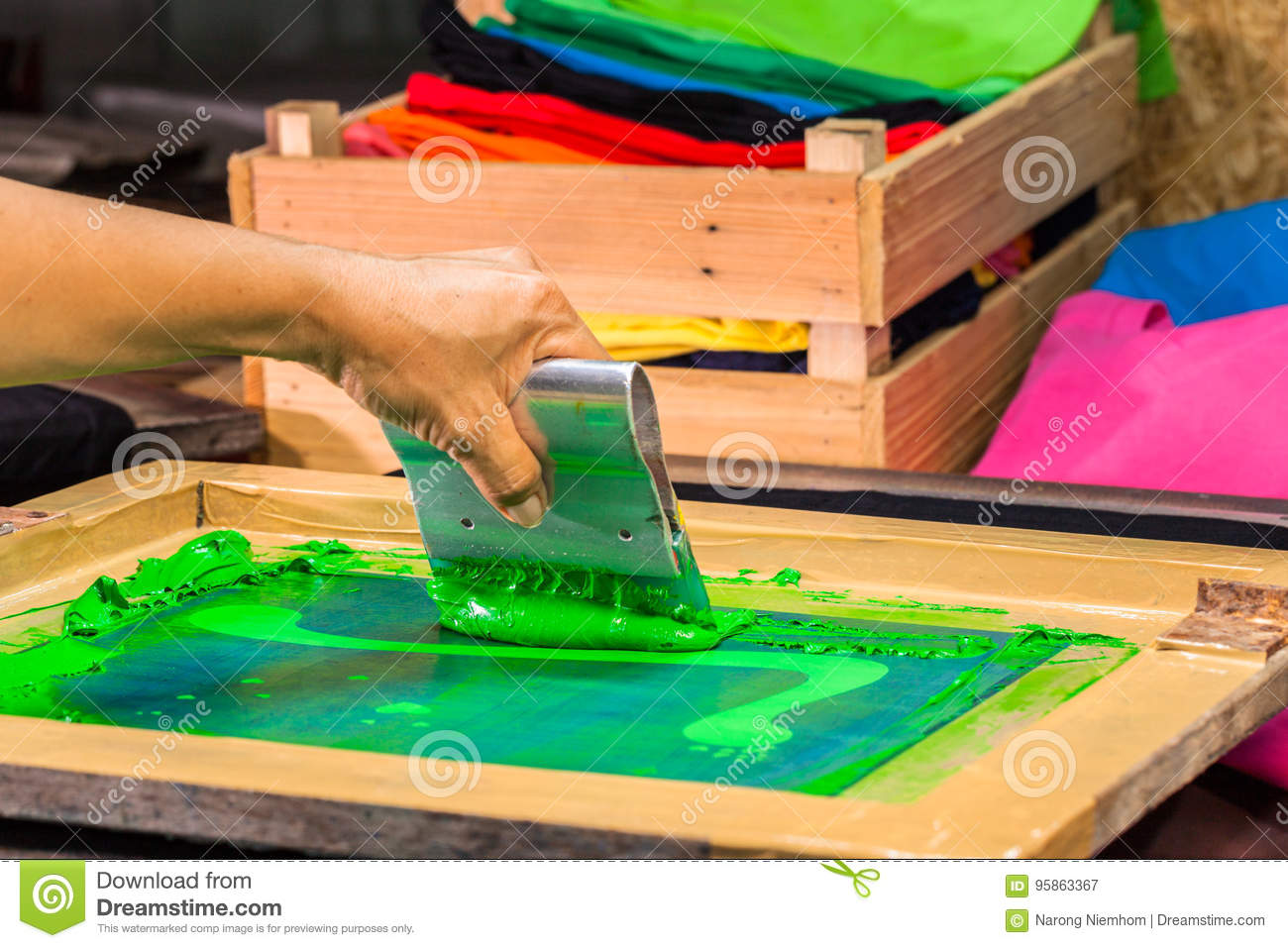 9e03b3f3 hand made screen printing tee shirt in love design. put block screen print  of green color on tee shirt put green ink on block screen the press green  ink by ...