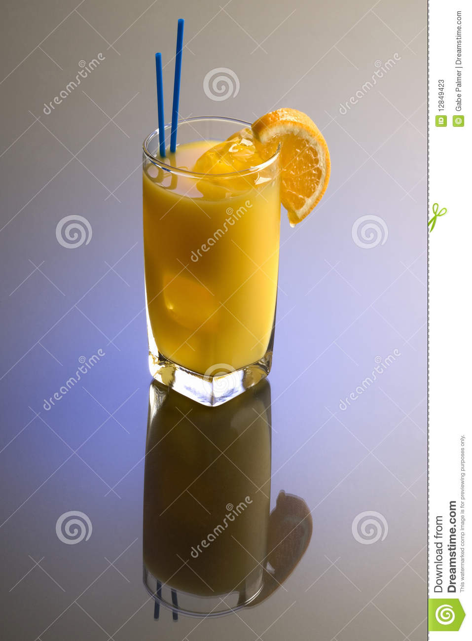 Screwdriver cocktail with orange garnish on plain background with ...