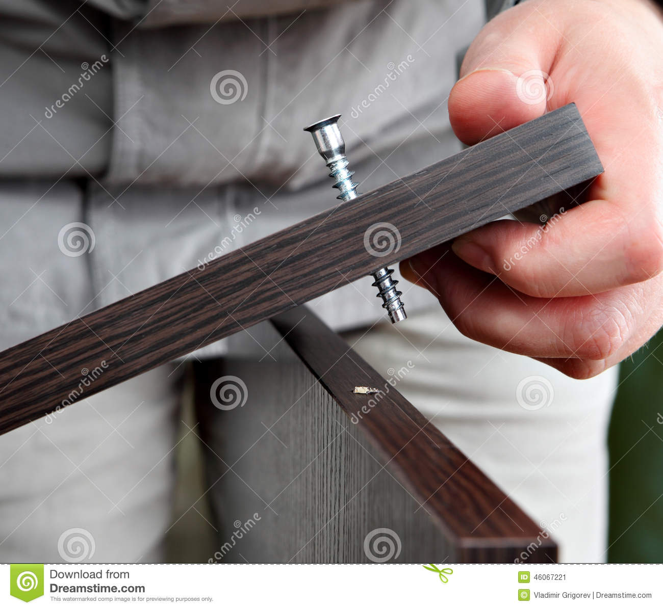 Wood Connection Hardware : Screwing in chipboard furniture wenge stock image