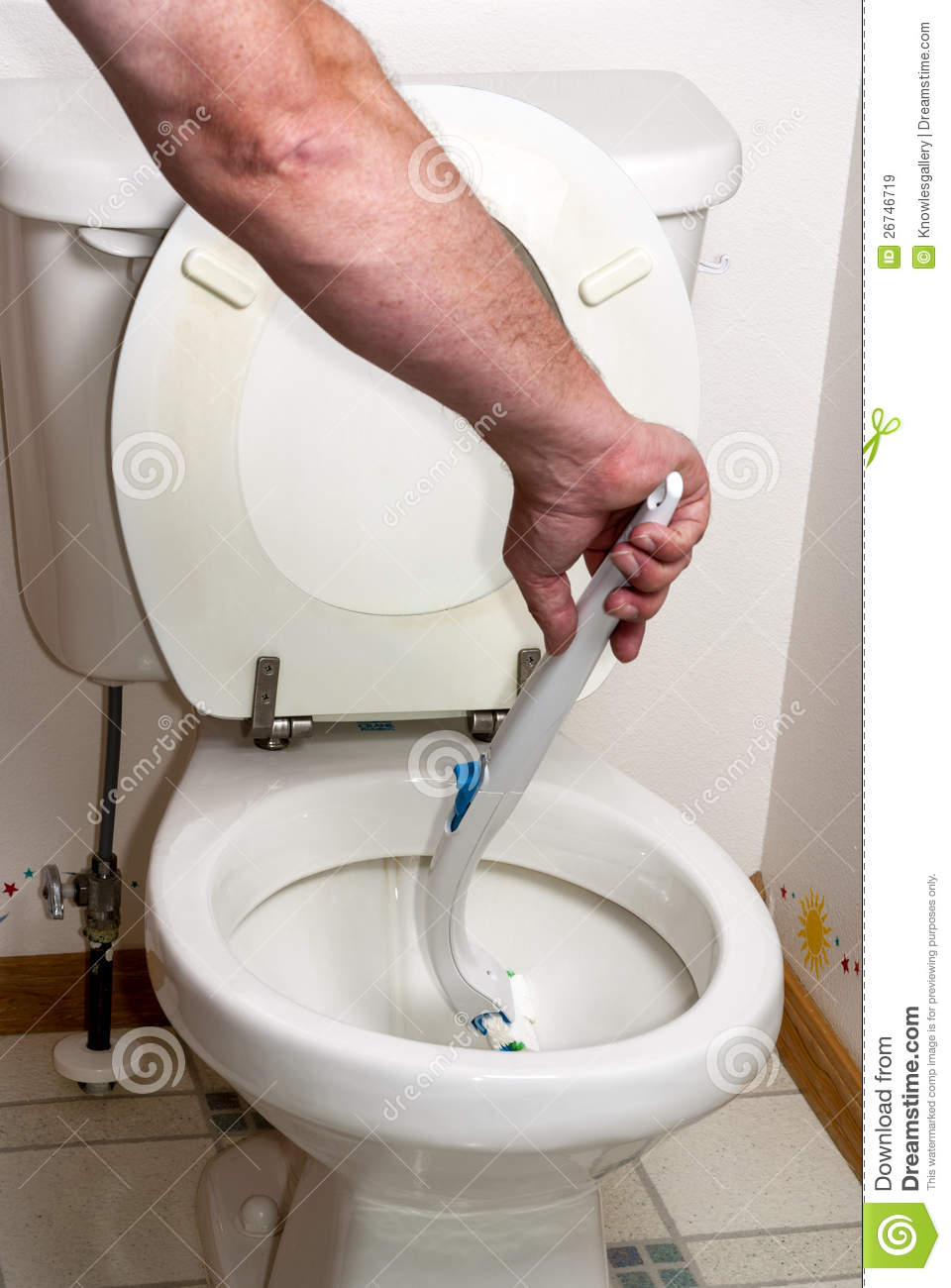 Scrubbing A Toilet With A Wand Royalty Free Stock Images