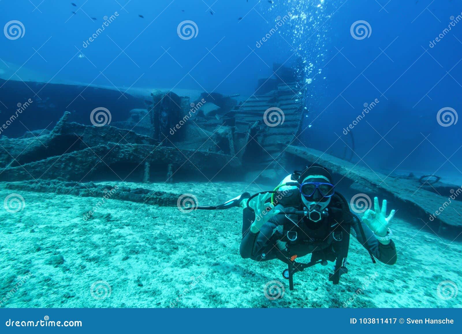 Scuba diver during a wreck dive in Greece