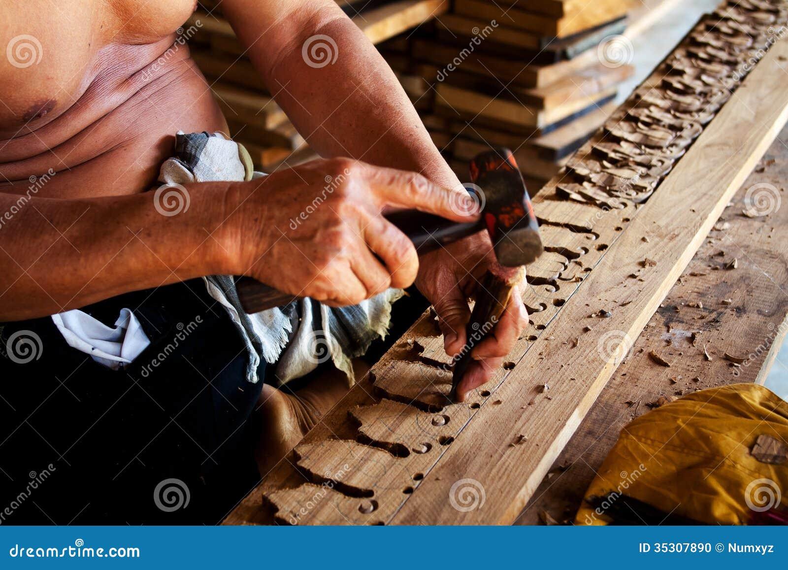 sculptor carving wood delicate beautiful 35307890 jpg