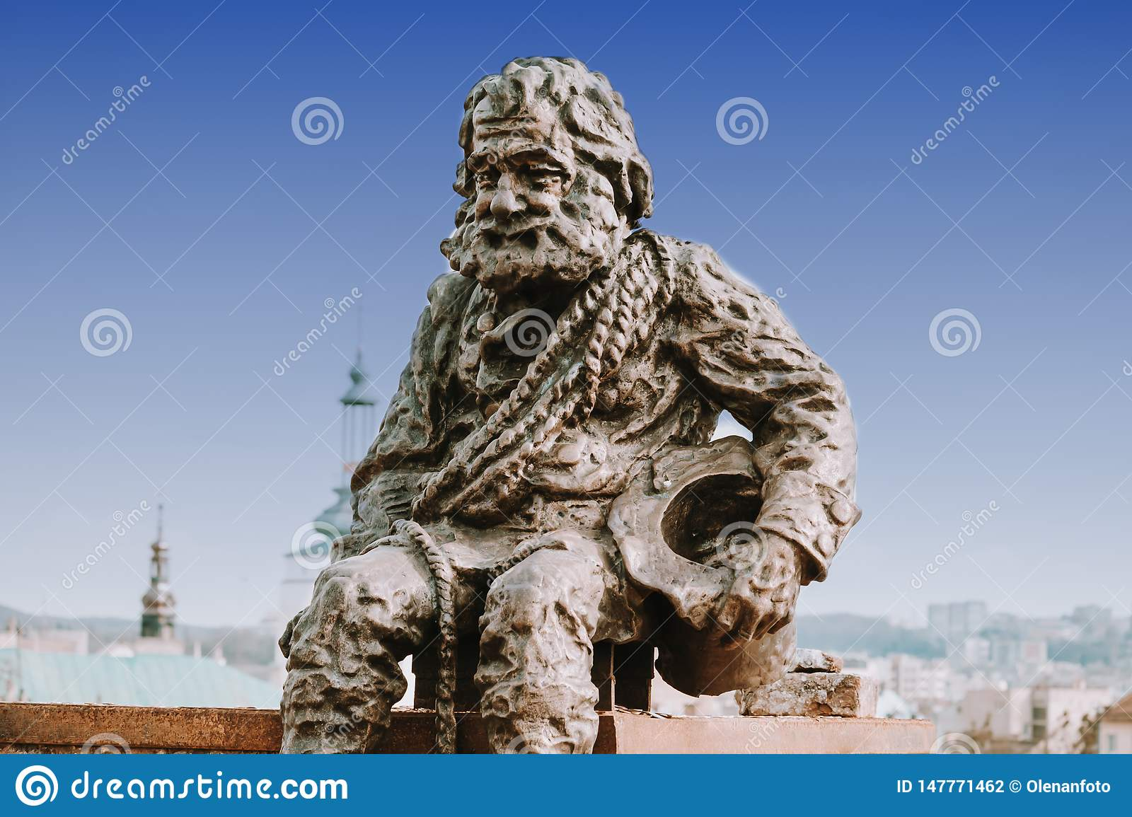 Sculpture a chimney sweep on the roof of the House of Legends in Lviv, Ukraine. Lvov is the most attractive city for tourists in
