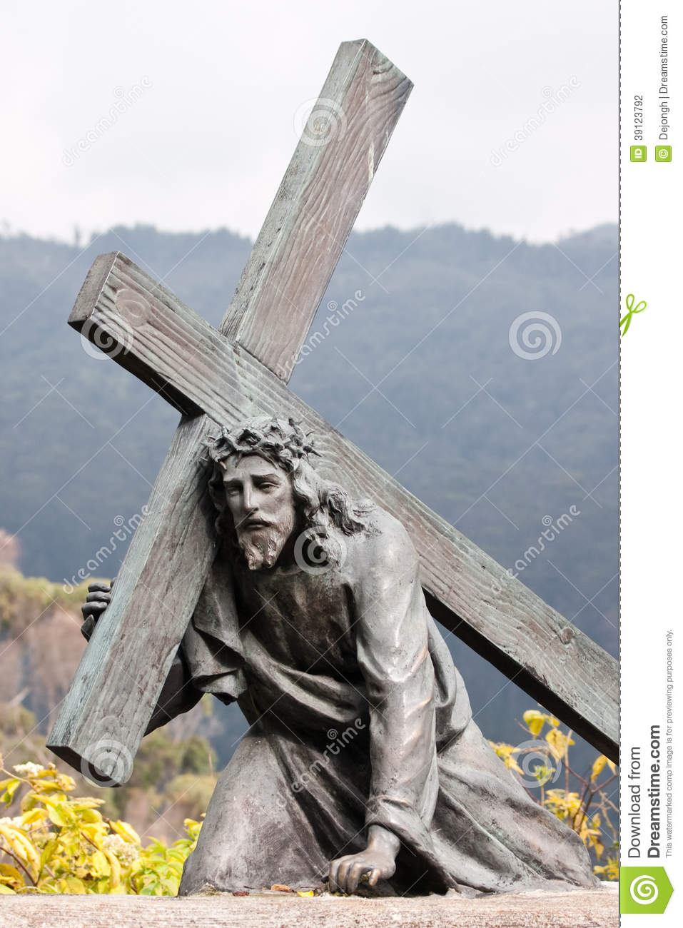 sculpture of christ carrying the cross editorial photography image