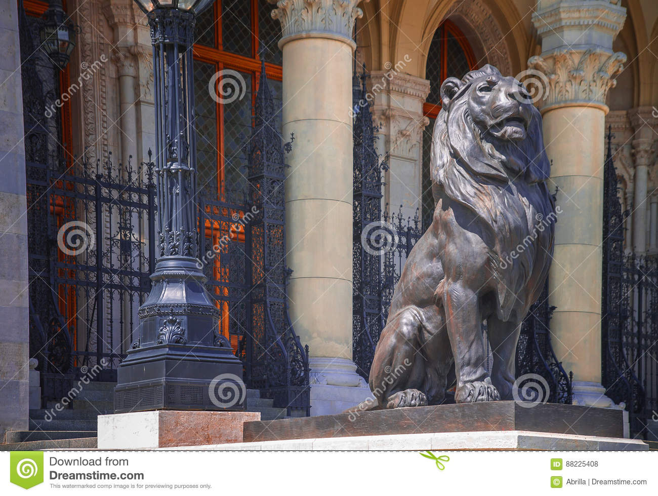 Sculpture of a lion near the Parliament building in Budapest