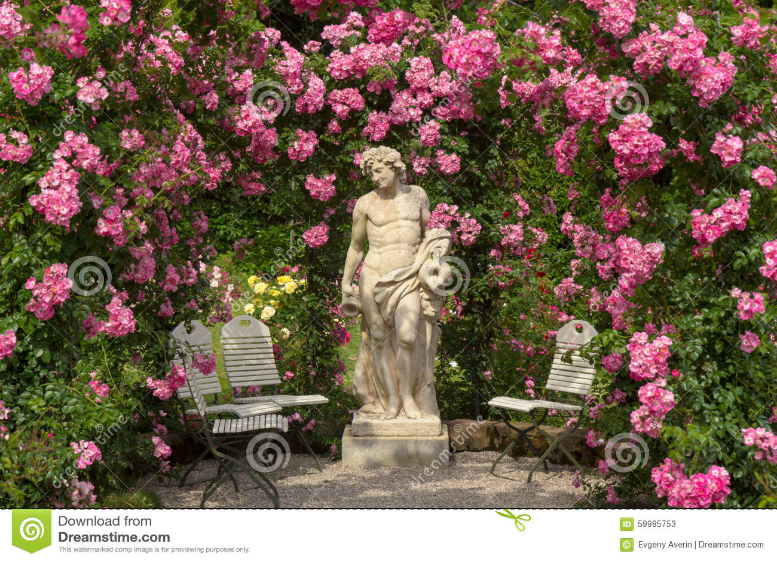 Roses In Garden: A Sculpture In A Rose Garden In Baden-Baden Stock Photo