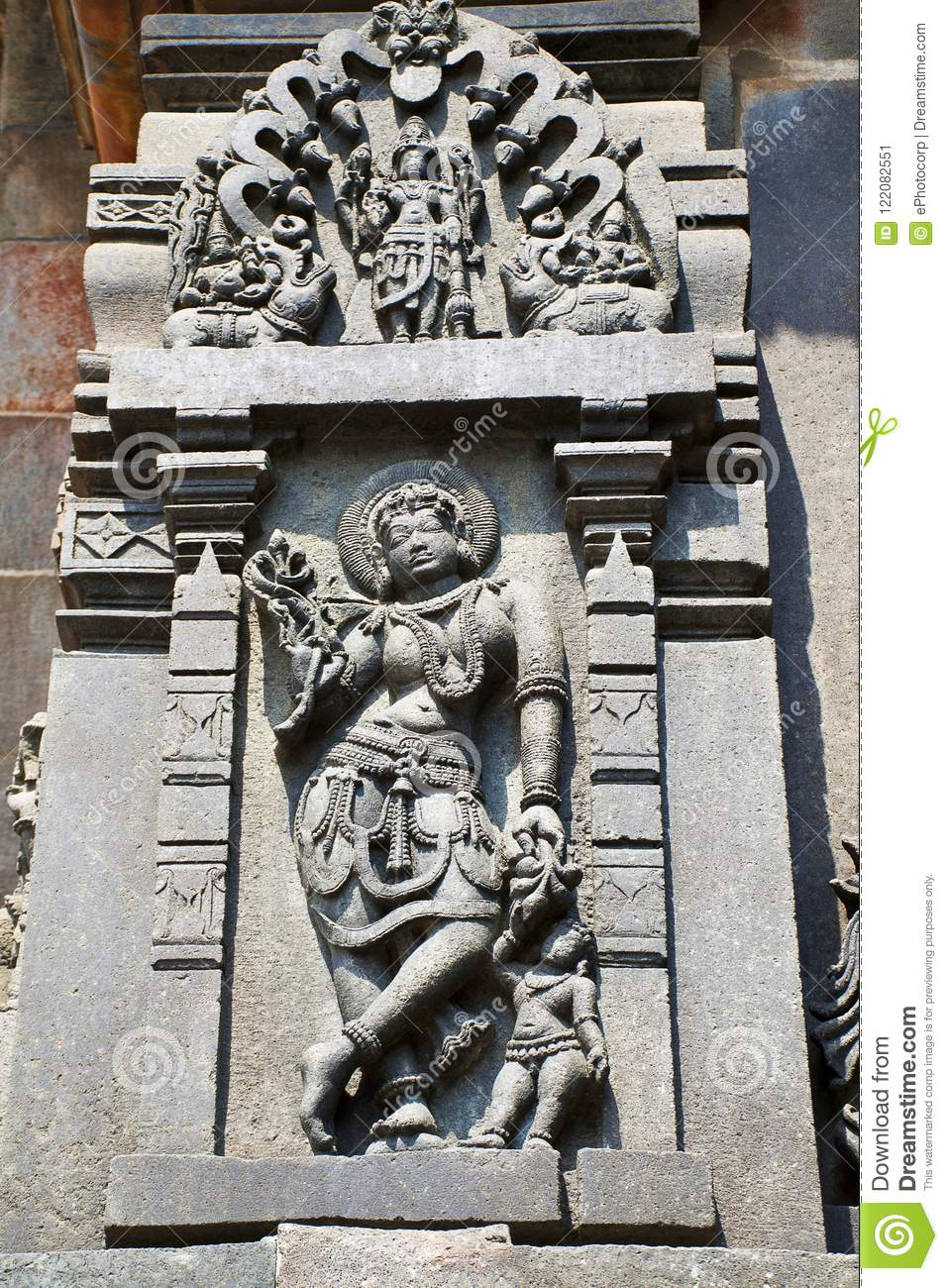 Sculpture of a Sundari, Beatiful Lady, going out with her child. Chennakesava temple, Belur, Karnataka.