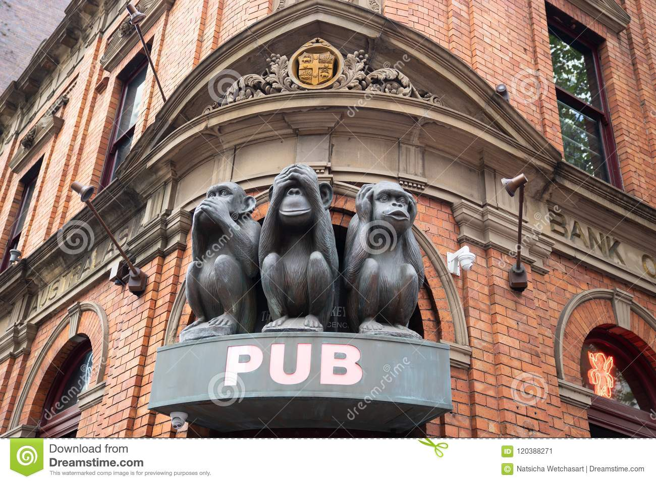 The Sculpture of Tree monkeys with different faces, No Speak, No See, No Hear on the gate of pub in Sydney