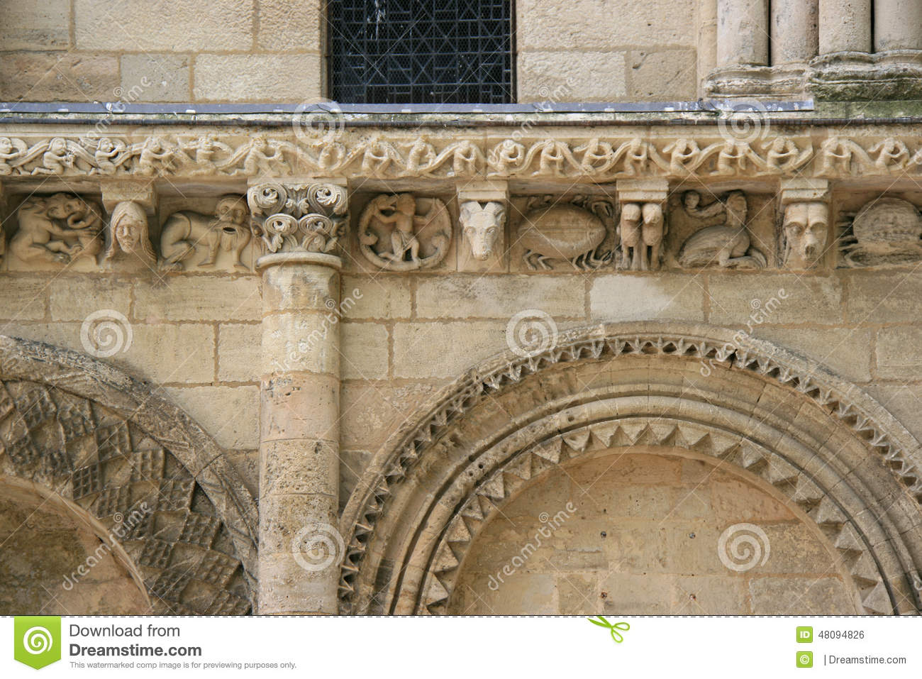 Sculptured animals and fantastic characters decorate the facade of a church (France)