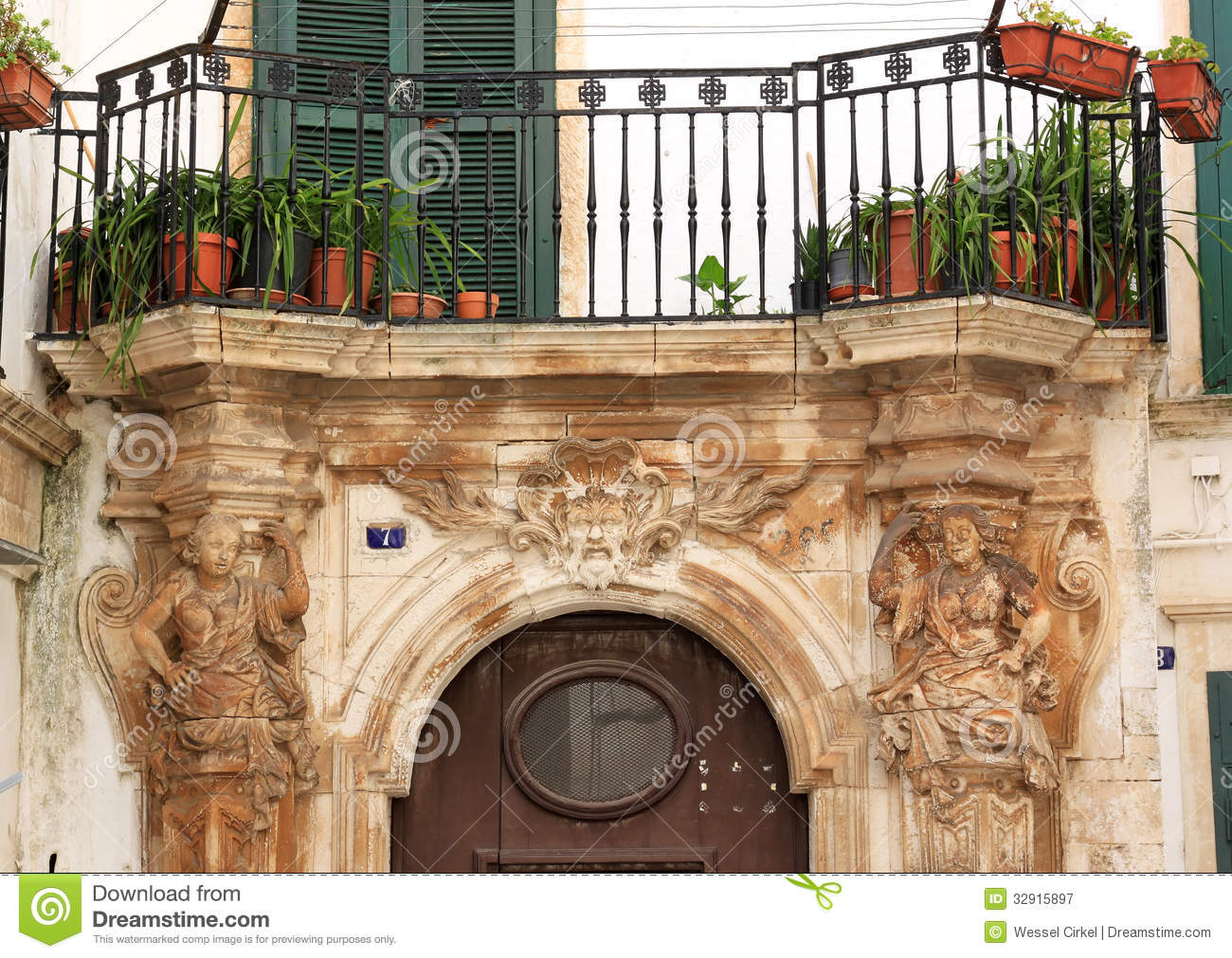 Sculptures and balcony in martina franca italy royalty for Balcony in italian