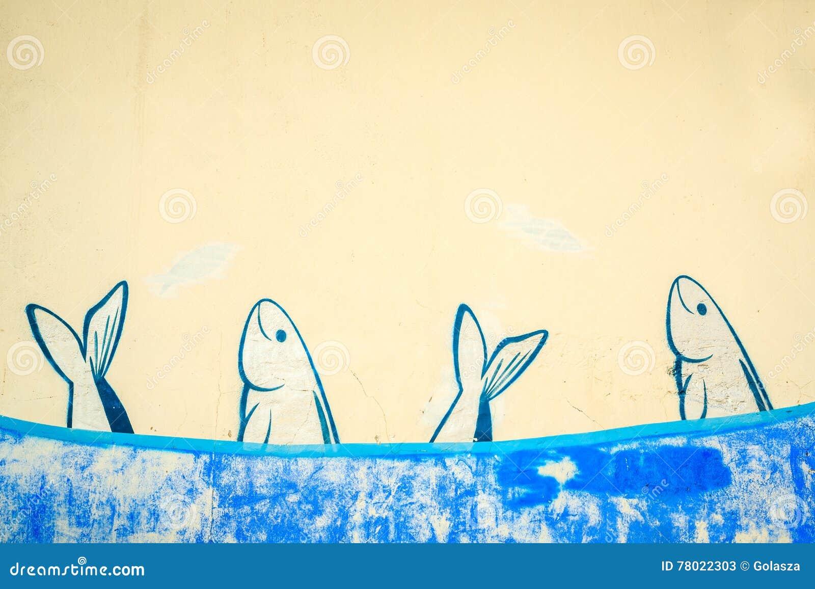 Scuola delle sardine dipinte sulla parete