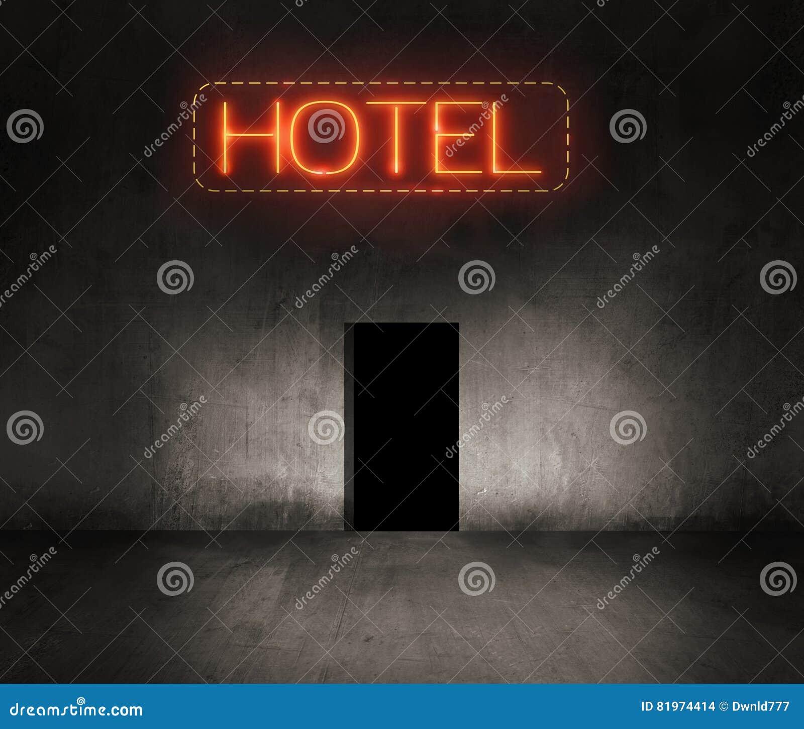 Señal de neón del hotel en la noche