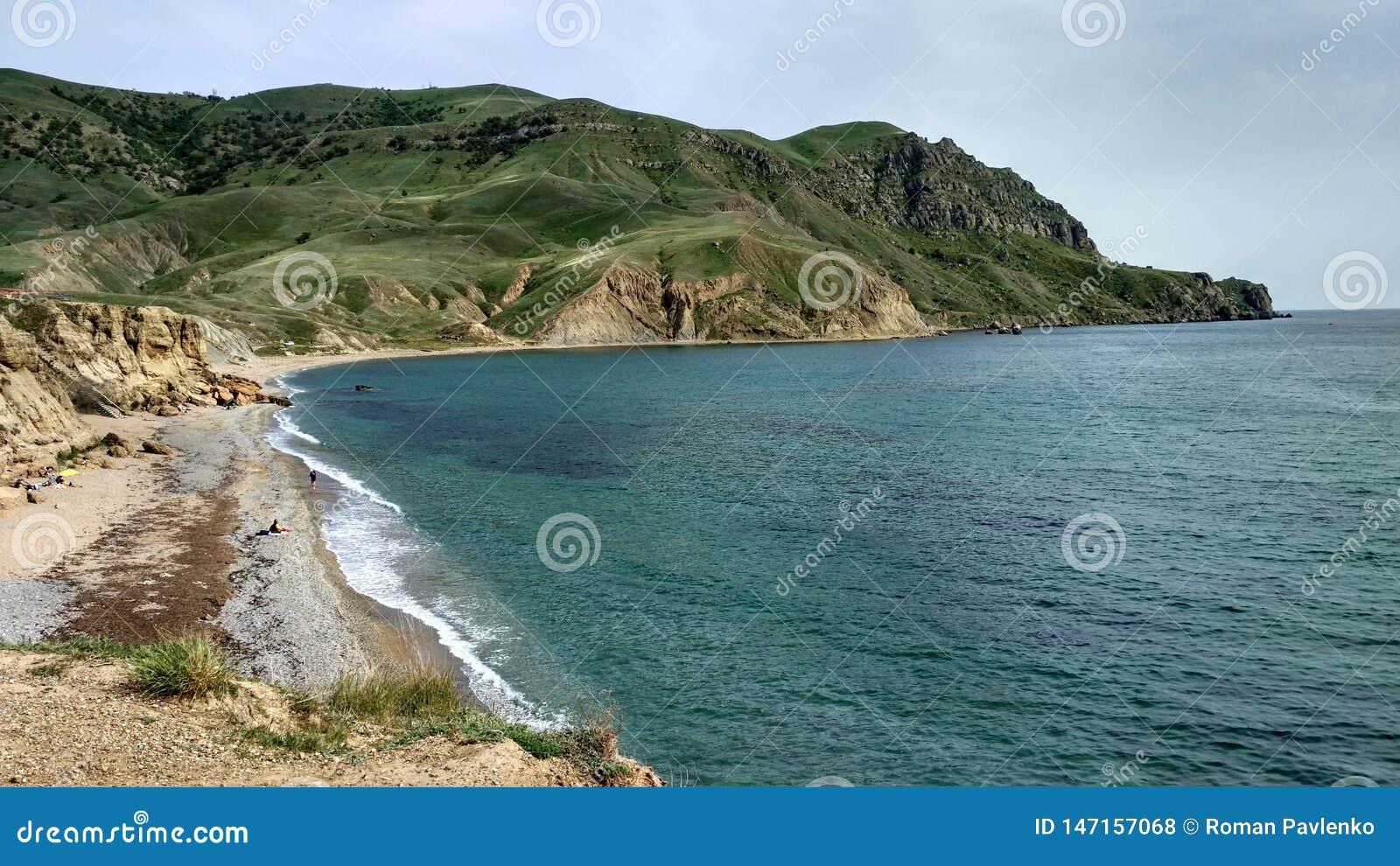 Sea coast and green cape
