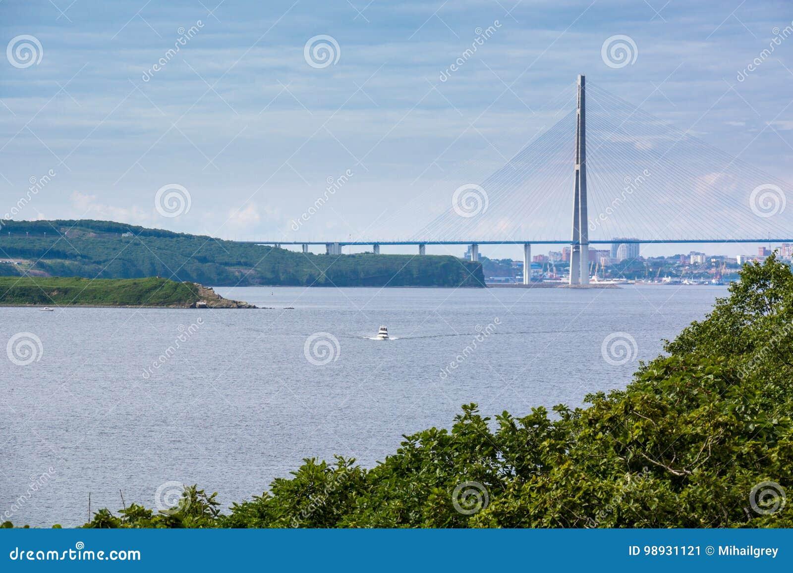 Sea bay and big bridge on background.