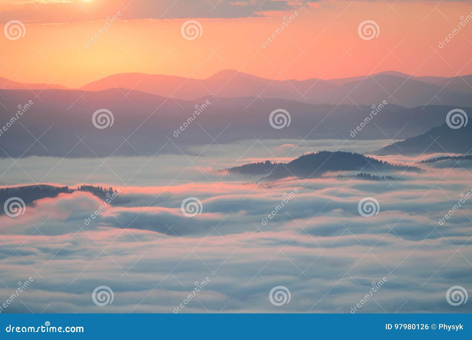 Sea of clouds in mountain at sunrise. Carpathians, the ridge Borzhava, Ukraine.
