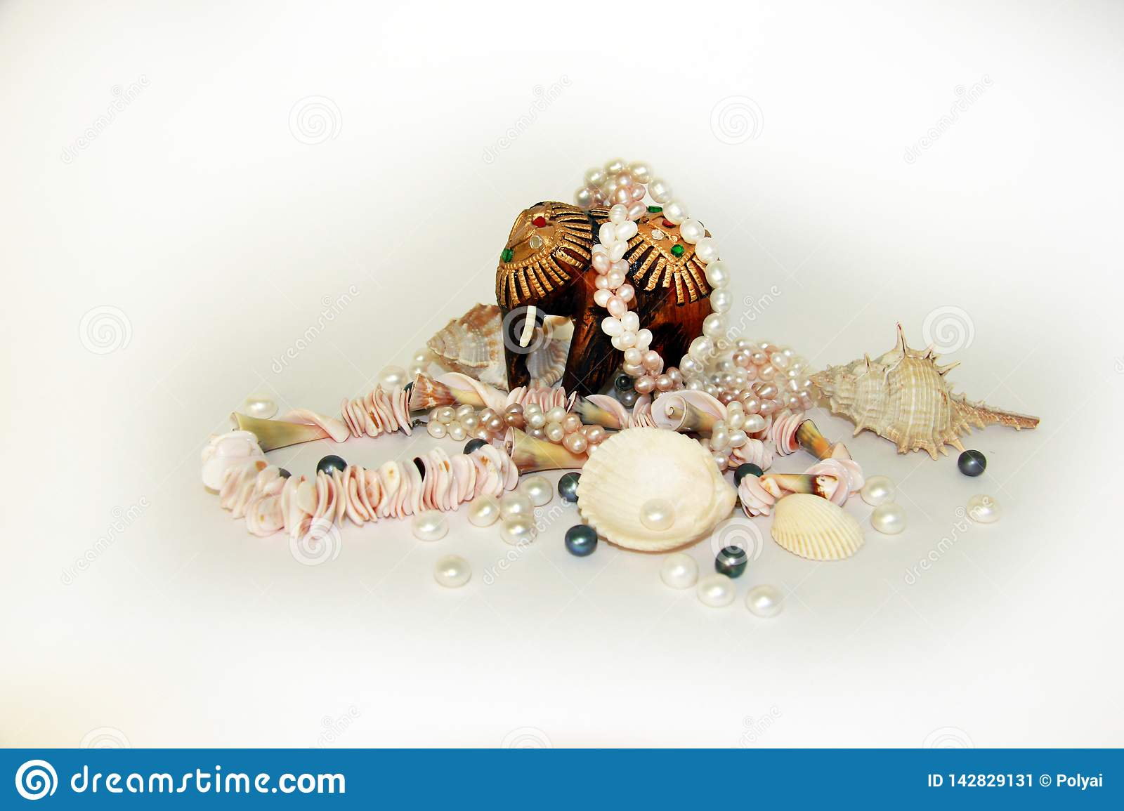Sea cockleshells and pearls on a black background