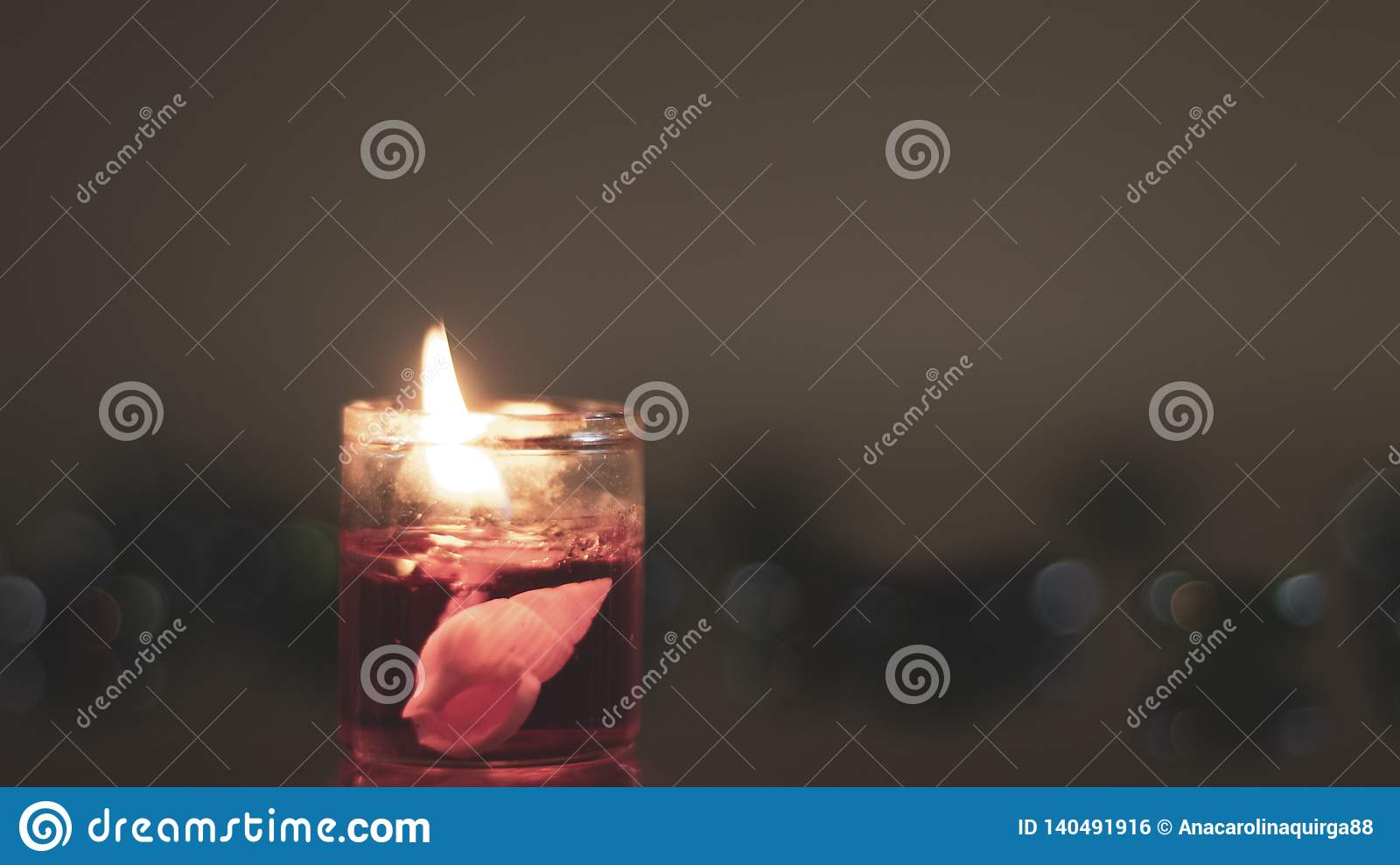 Marine objects inside a candle. Warmth and delicacy in a glowing adornment.