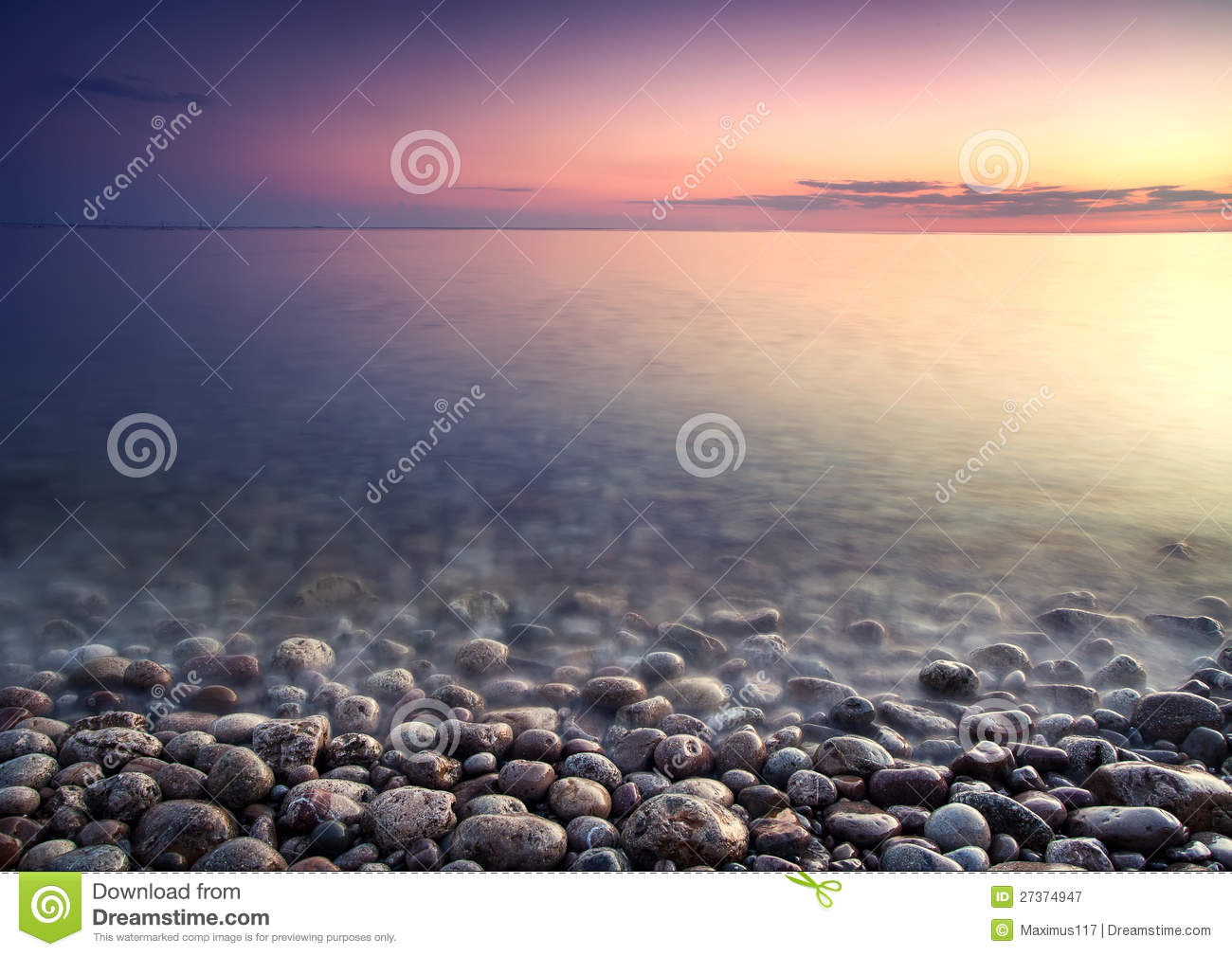 Sea pebble. Nature composition of sunset.