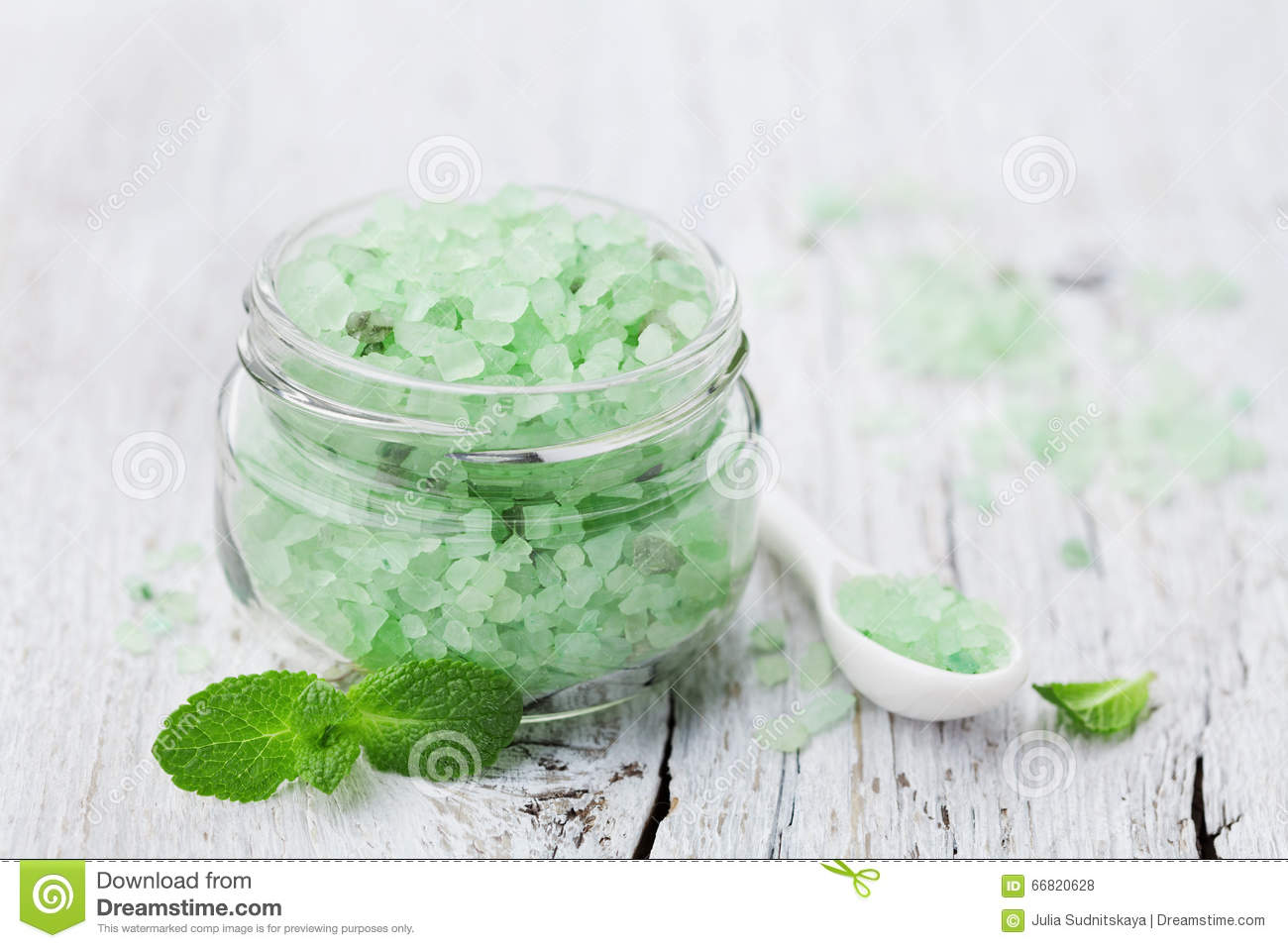 Sea salt bath scented mint for spa and aromatherapy on white wooden background