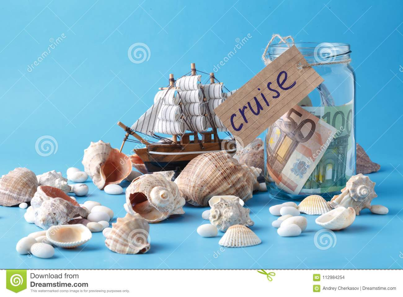 Sea shells on blue, vacaton concept on plain background