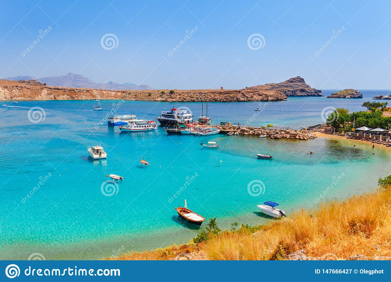 Sea skyview landscape photo Lindos bay and sea coast on Rhodes island, Dodecanese, Greece. Panorama with nice sand beach and clear