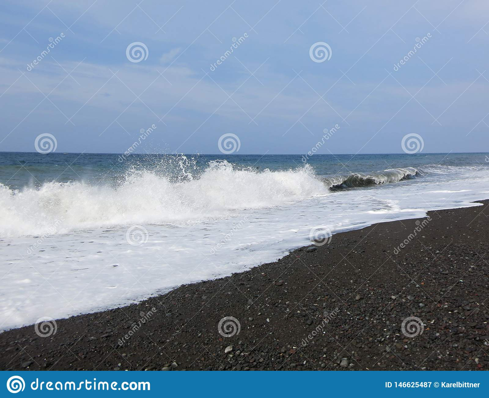 Sea surf and waves crashing onto the beach