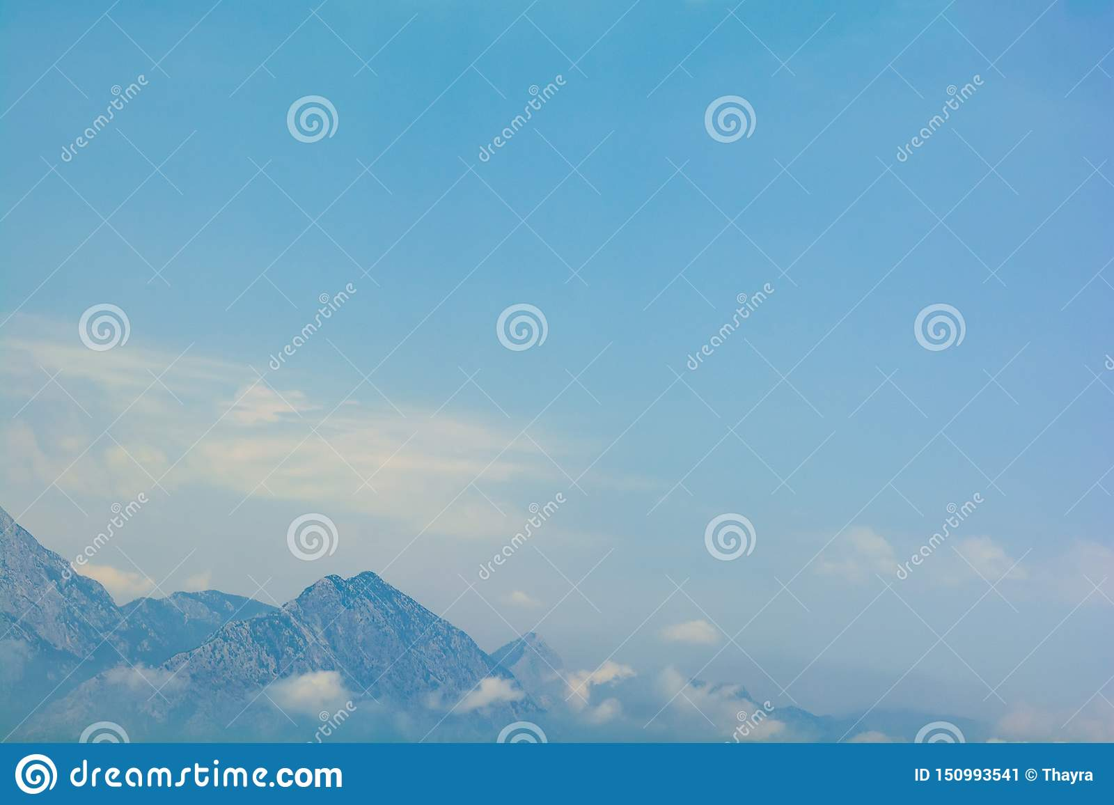 Sea view on peaks of Taurus Mountains covered by low clouds and fog from boat. Travel concept. Soft focus