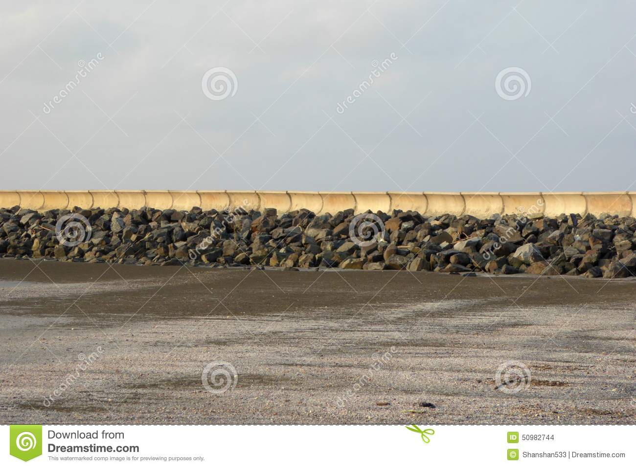 Can Gio Vietnam  city pictures gallery : sea wall and pier along beach,pile of stones at can gio Vietnam.