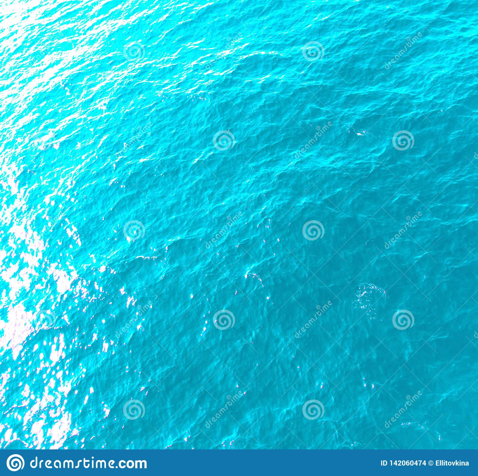 Sea Water Background In Light Blue With Sun Highlights Stock