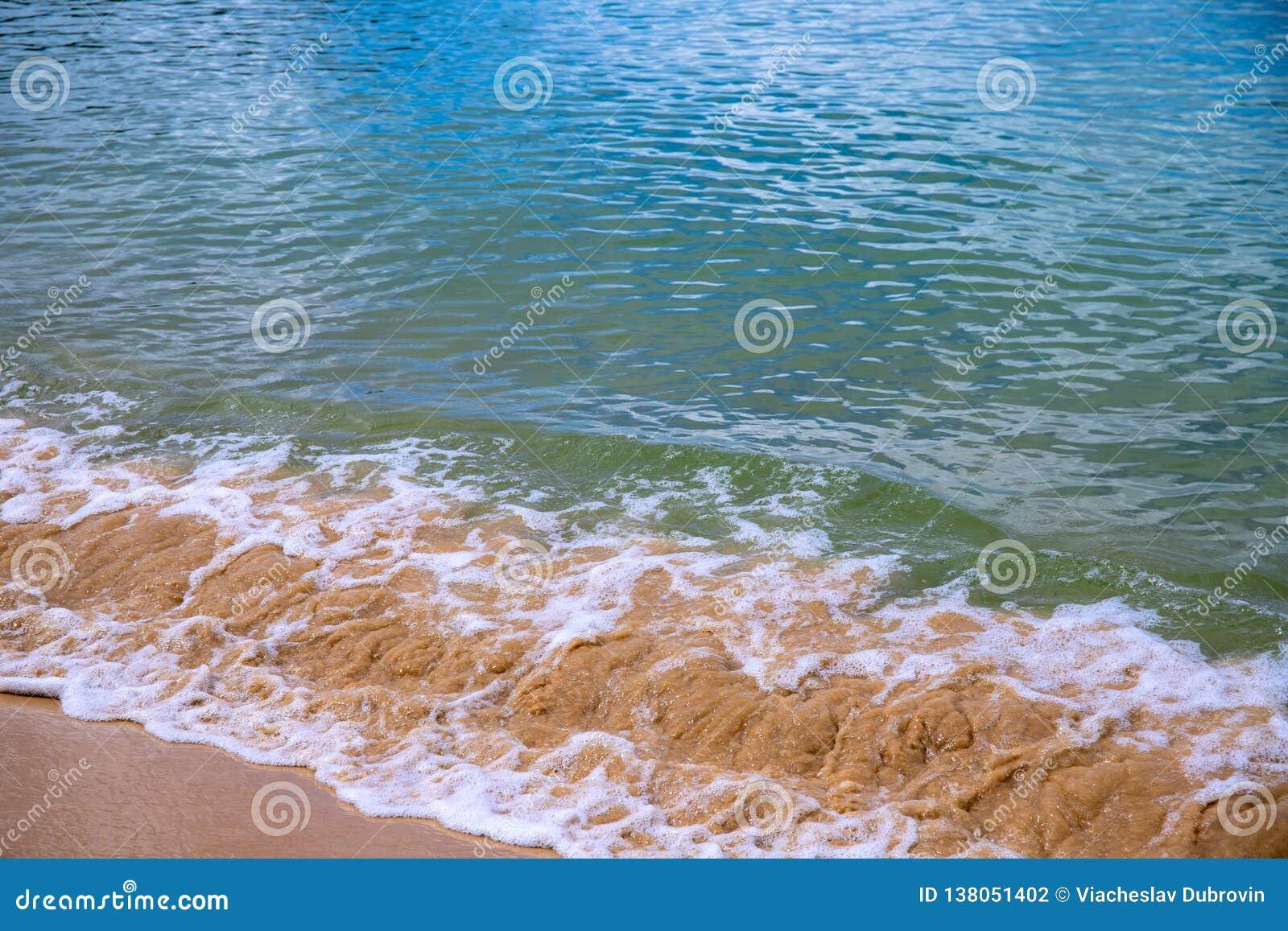 Sea Water Tide Over Yellow Sand Beach. Tropical Seaside