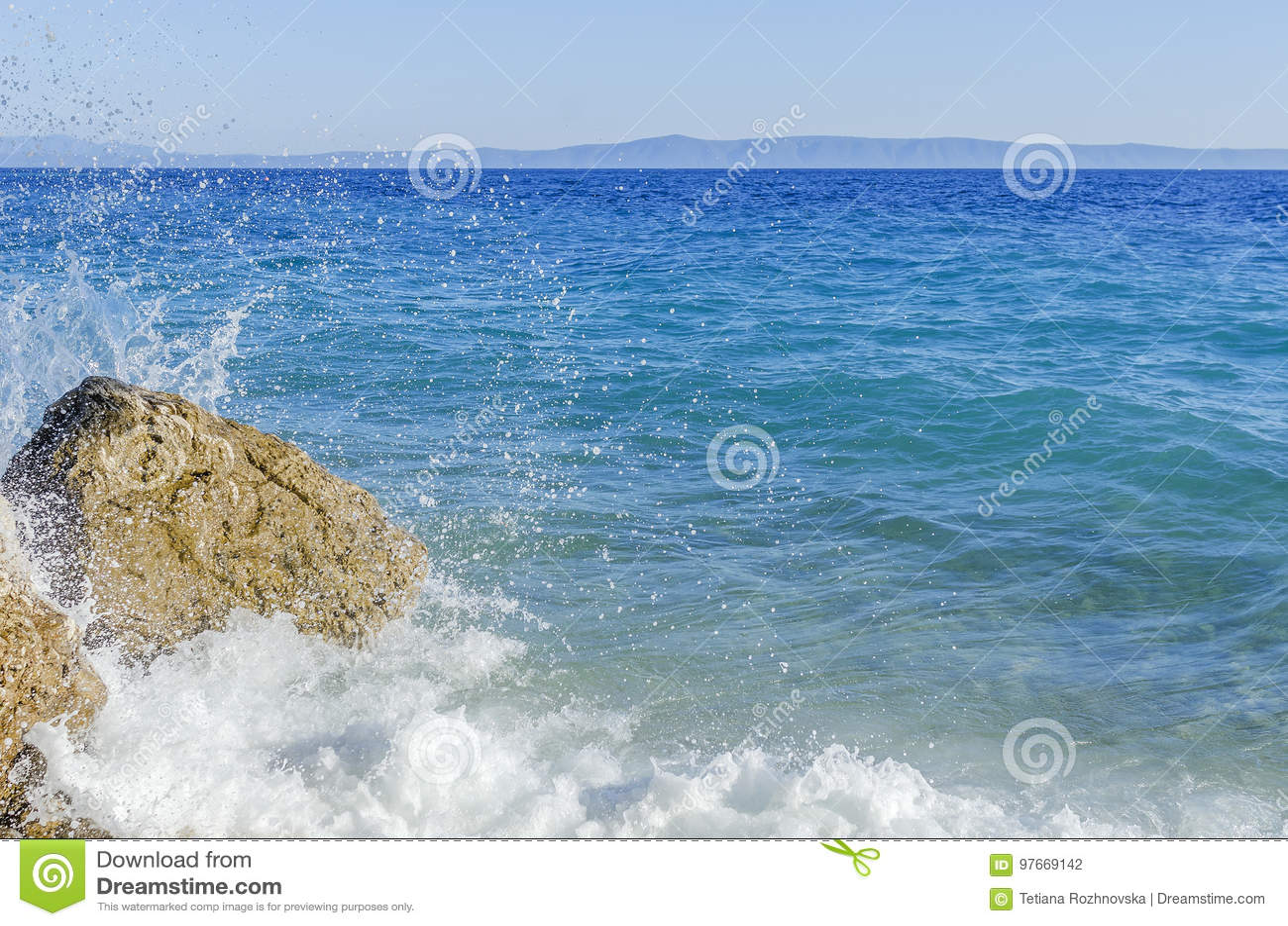 Sea wave is broken about stones.